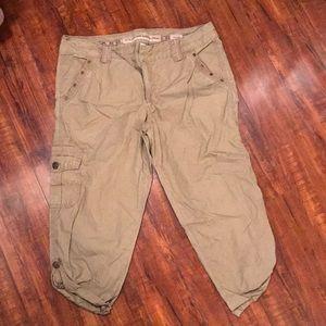 Khaki colored cargo pants, cropped legs